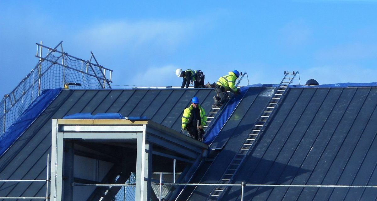 Zinc Roofing and Cladding 4. Longworth Dumfries & Galloway Hospital, zinc operatives installing 10m sections of NedZinc Nova standing seam off Cat ladders fixed to custom hook-on point