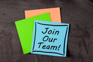 Post it note saying join our team
