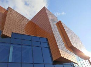 Orange aluminium cladding in shingle format