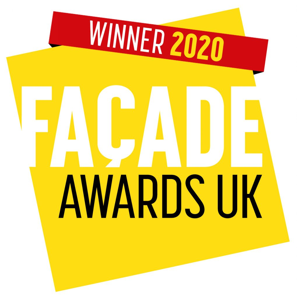 Winners logo for facade awards. yellow square with red sash across