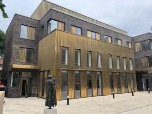 Brass coloured metal clad residential building in Hackney London RCI Magazine Facade Awards 2021!